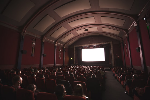 Picture of people in a cinema in front of a blank screen